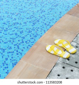 women's sandals  by a swimming pool