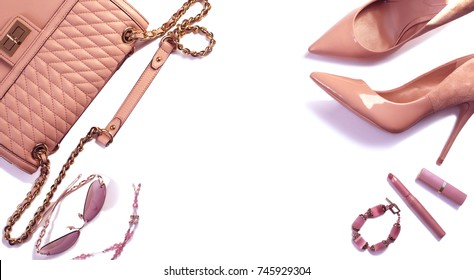 Women's set of fashion accessories in pink color on white background: shoes, handbag, sunglasses, lipsticks and jewelry