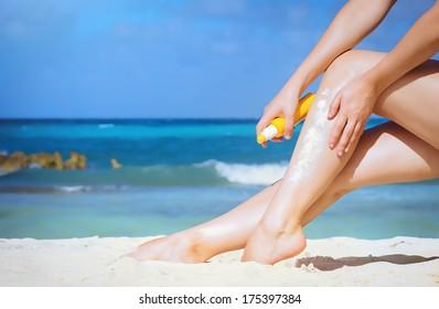 Women's sexy legs on the beach