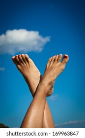 Women's sexy legs on the sky. Summer vacations concept