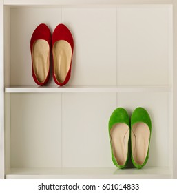 Women's shoes (ballet shoes) in the white wardrobe. Selective focus