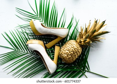 Women's shoes with green leaves and gold pineapple