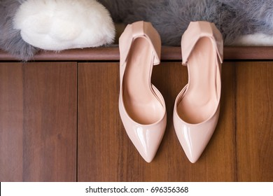 Women's shoes are on the closet