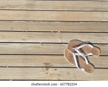 Women's shoes on the path of boards with a wet footprint