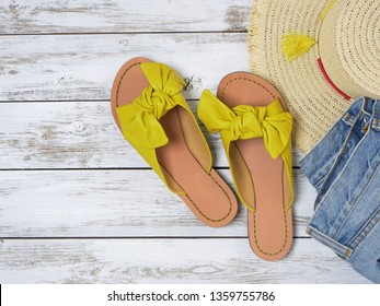 Womens shoes (yellow leather sandals with knotted bow). Fashion outfit, spring summer collection. Shopping concept. Flat lay, view from above