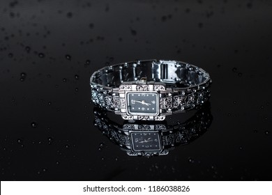 Women's silver wrist watch isolated on black
