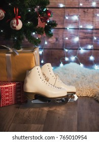 Women's skates next to an old leather suitcase and a Christmas tree. Christmas Decorations
