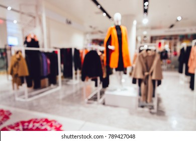 Women's stylish boutique. Blurred image of designer clothes. Shopping concept.