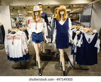 Women's stylish casual clothing in store at display window,