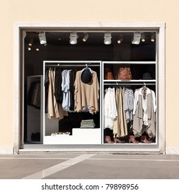 Women's stylish casual clothing in store at display window, autumn collection