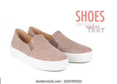 Women's suede shoes isolated on a white background. Slip on star design sneakers.
