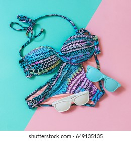 women's swimsuit  and sunglasses painted in blue and white. fashion summer. flat lay