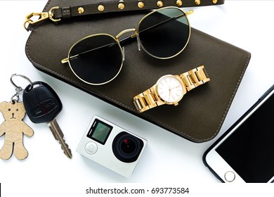 women's travel set to holiday and action camera and gold watch and wallet and smart phone and car key and sunglases