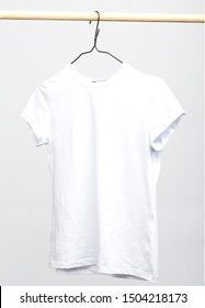 Women's t-shirt hanging separately on a trempel