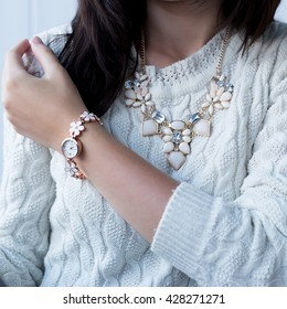 Women's Watch and necklace on girl