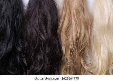 Women's wigs of different shades. Blonde brunette brown-haired woman.