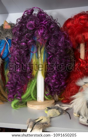 Women s wigs made of artificial hair of different colors on special wooden  blanks 39ba460b5