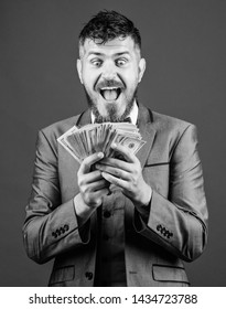 Won a cash prize. Bearded man holding cash money. Making money with his own business. Business startup loan. Rich businessman with us dollars banknotes. Currency broker with bundle of money.