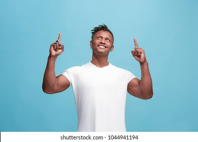 I won. Winning success happy afro man celebrating being a winner. Dynamic image of afro-american male model on blue studio background. Victory, delight concept. Human facial emotions concept. Trendy