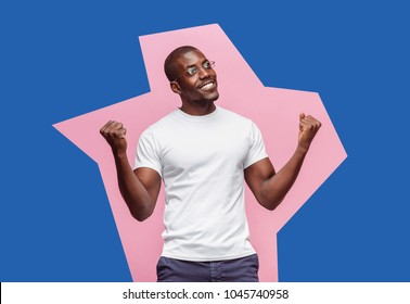 I won. Winning success happy man celebrating being a winner. Dynamic image of afro male model on studio background. Victory, delight concept. Human facial emotions concept. Trendy colors. Pop art