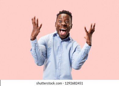 I won. Winning success happy man celebrating being a winner. Dynamic image of afro male model on pink studio background. Victory, delight concept. Human facial emotions concept. Trendy colors