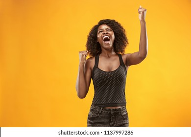 I won. Winning success happy woman celebrating being a winner. Dynamic image of caucasian female model on yellow studio background. Victory, delight concept. Human facial emotions concept. Trendy