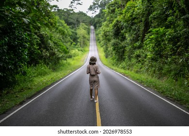 Wonan in safari suit walk on the road at Khaoyai natural park