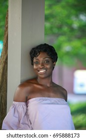 Wondefull African American woman posing, looking at camera on the street, Beautiful eyes of a black woman with short hair