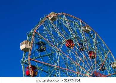 Wonder Wheel in Coney Island against blue cloudless sky. Photographed in September 2015.