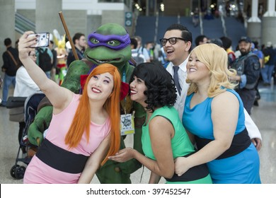 WONDERCON: Los Angeles Convention Center, March 25 thru 27, 2016. Cosplayers dressed as the Powerpuff Girls and Professor X with Donatello of the Teenage Mutant Ninja Turtles at the convention in LA.
