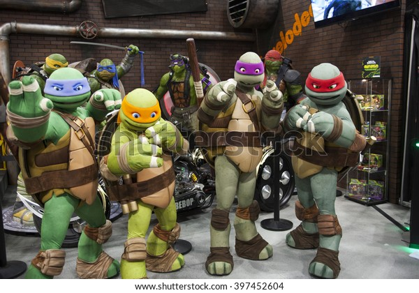 WONDERCON: Los Angeles Convention Center, March 25 thru 27, 2016. Teenage Mutant Ninja Turtles pose for a photo at their booth.