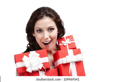 Wondered woman hands a lot of present boxes with white bows, isolated on white