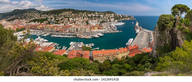 Wonderful aerial panoramic view of Nice Old port and colorful historical houses in the sunny summer day with blue sky, Nice, French Riviera, Cote d'Azur, France