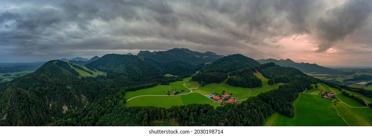 Wonderful aerial view over idyllic farmland in mountainrange to the bavarian alps at the recreation and hiking aera Chiemgau in southern germany.