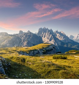 Wonderful Alpine highlands during sunrise. Morning view of Dololites mountains, Italian Dolomites Alps under sunlight. Awesome landscape with colorful sky over the Cadini di Misurina range