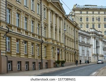 Wonderful architecture of Baltic countries. Vilnius street. Old city. Ancient European town. Urban landscape. People walk along a road. Lithuania, Vilnius - April 27, 2017