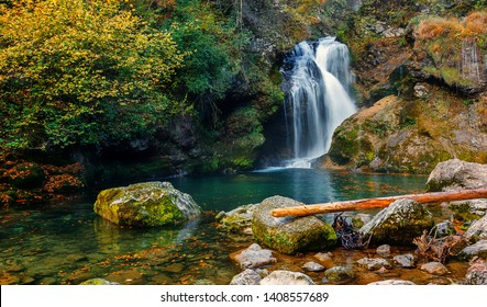 Wonderful Autumn landscape with Beautiful little waterfall in forest. Waterfall at Soteska vintgar, Slovenia. The Vintgar Gorge in Julian Alps, Slovenia. or Bled Gorge. Amazing nature Scenery
