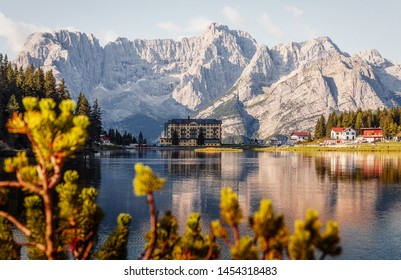 Wonderful Autumn Landscape. Great view on Misurina Lake with the Punta Sorapis mountain of Dolomites in the background, in sunny day. National Park Tre Cime di Lavaredo, Auronzo, South Tyrol, Italy,