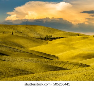 wonderful autumn landscape of Tuscan fields,on the background dangerous storm clouds