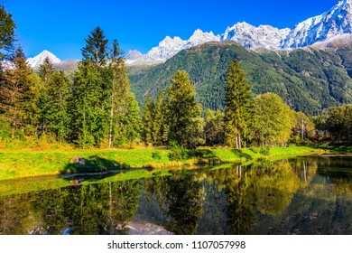Wonderful autumn warm day in the French Alps. Chamonix City Park is illuminated by sunset. Concept of active winter touris