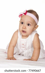 wonderful baby in a  dress on a white background