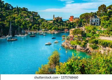 Wonderful bay with colorful mediterranean buildings and boats, yachts in spectacular vacation resort, Portofino, Liguria, Italy, Europe
