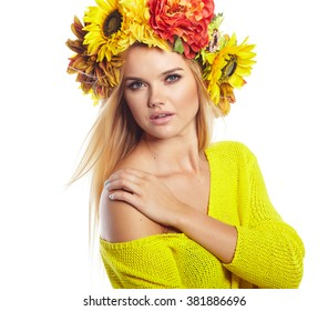Wonderful blonde lady with wreath from flowers on head