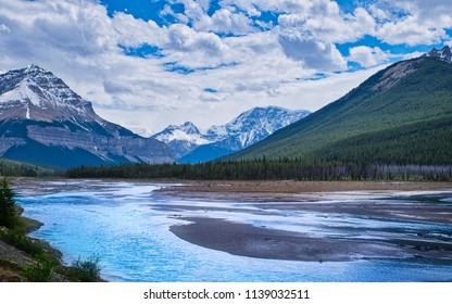 A wonderful blue river running through a valley in the Rocky mountains. A beautiful scenery!