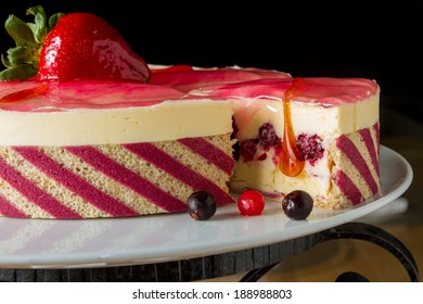 Wonderful cake tart with side stripes decor and blackberry filling. See more shot of this cake