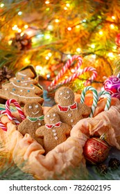 A wonderful Christmas card. Christmas traditional ginger biscuits in the form of Christmas trees and cheerful little men. Cookies in the form of a happy family.
