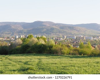 Wonderful cityscape landscapes of european Bielsko-Biala city and countryside with green grassy meadow at Beskid Mountains range in POLAND and clear blue sky in 2018 warm sunny spring day on April.