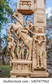 wonderful close up view of sculptures of man playing a drum (thavil in tamil), playing a Shehnai (Nadaswaram in tamil), riding a horse, and an anicent woman greeting chennai india tamil nadu