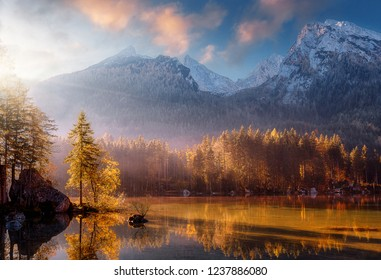 Wonderful Colorful Sunset at Hintersee Lake in Bavarian Alps. Awesome Alpine Highlands during sunrise. Amazing Autumn Natural Background. Incredible Nature Landscape. Beautiful locations of the World