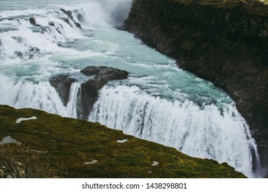 Wonderful contrasts of Gullfoss waterfall. Blue and green waters